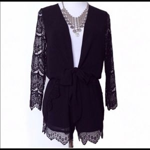 NWT Low Plunge black romper